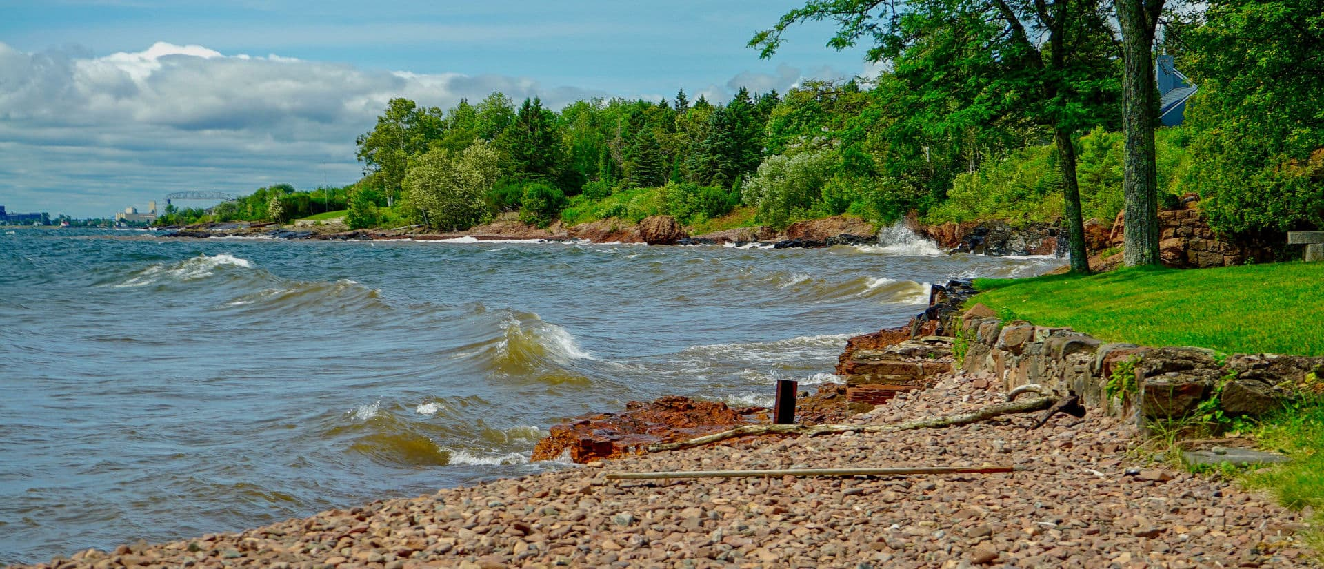 Beautiful scenic shore of Lake Superior in Duluth Minnesota in the summertime with the sun shining bright with blue skies